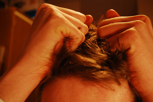 Stressed man pulling hair [CC]