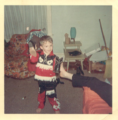 Pic #2: I think every male child over a certain age has a photo of himself in this cowboy outfit. I was at a book store the other day, and I swear, on the back of the book jacket, there was a photo of the author as a kid wearing this very same outfit. I'm cuter though. The foot belongs to my father. My mom says that I was trying to put my boots on my Dad's foot. I must have loved boots as a kid because I've got lots of photos of me wearing cowboy boots.