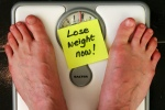 Lose Weight Now - Man's Feet on Scale (CC)