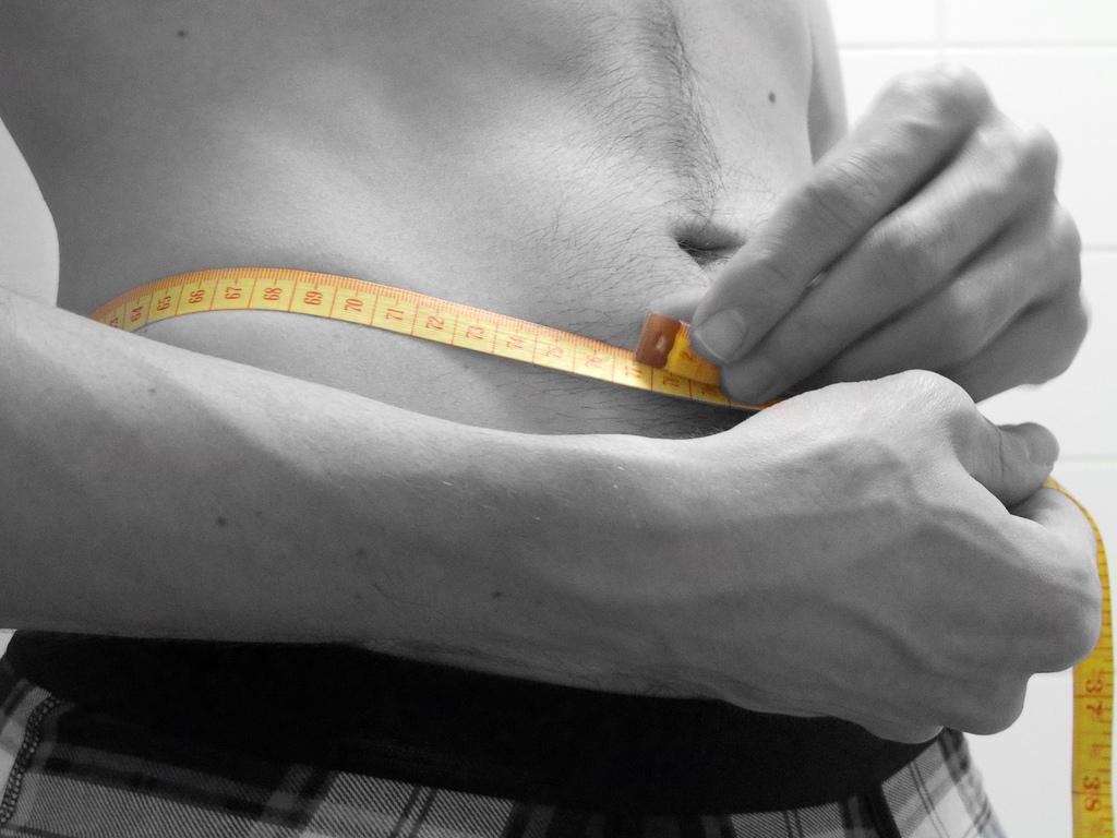 Man Measuring His Waist With a Tape Measure (CC) | 5-6-7-8