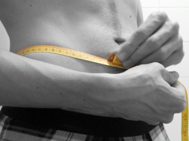 Man Measuring His Waist With a Tape Measure (CC)