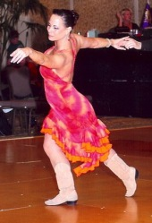Terri Bordeaux dancing with one of her students in a competition