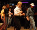 Group Line Dance Class in a Night Club (CC)