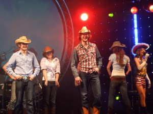 Line Dancers on stage (CC)