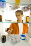 Man With Medicine Cabinet (CC)