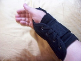 My arm in black brace