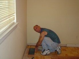My friend Steve installing hardwood floor in my old house