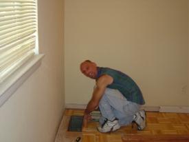 My friend Steve installing hardwood floor in my old house