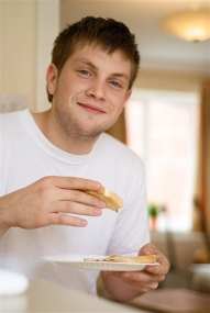 Man Eating and Smiling